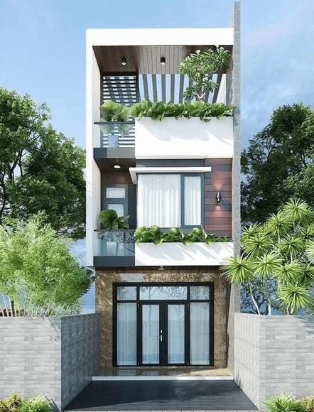 Nhà 2 lầu - 1 tum trồng cây xanh phía trên tạo cảm giác mát mẻ, hiện đại